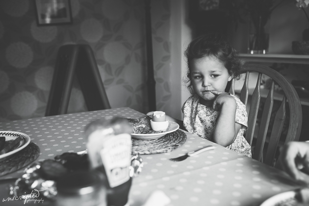 Child at breakfast captured by Northumberland documentary family photographer Claire Batey