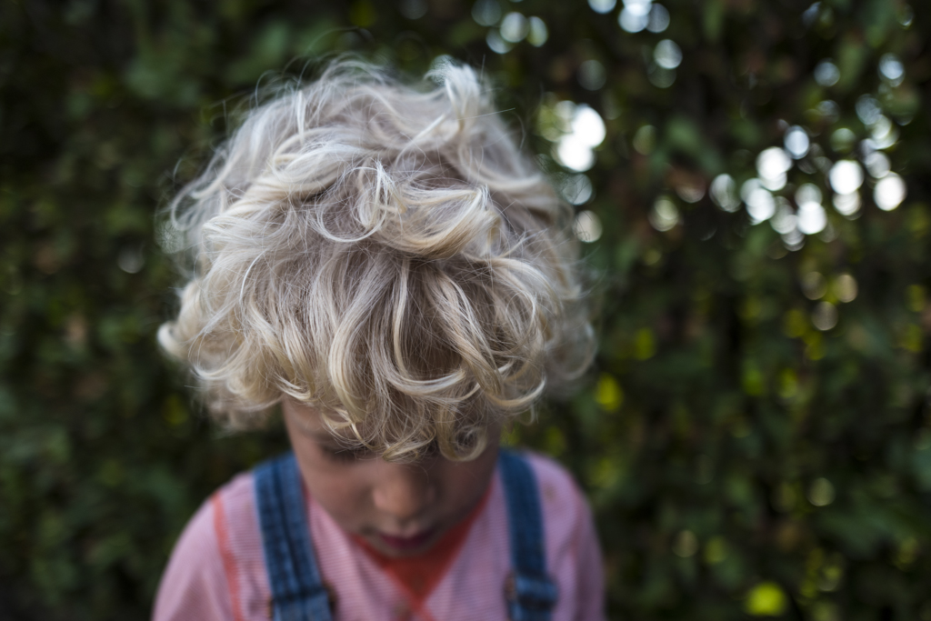 detail of curly hair on boy