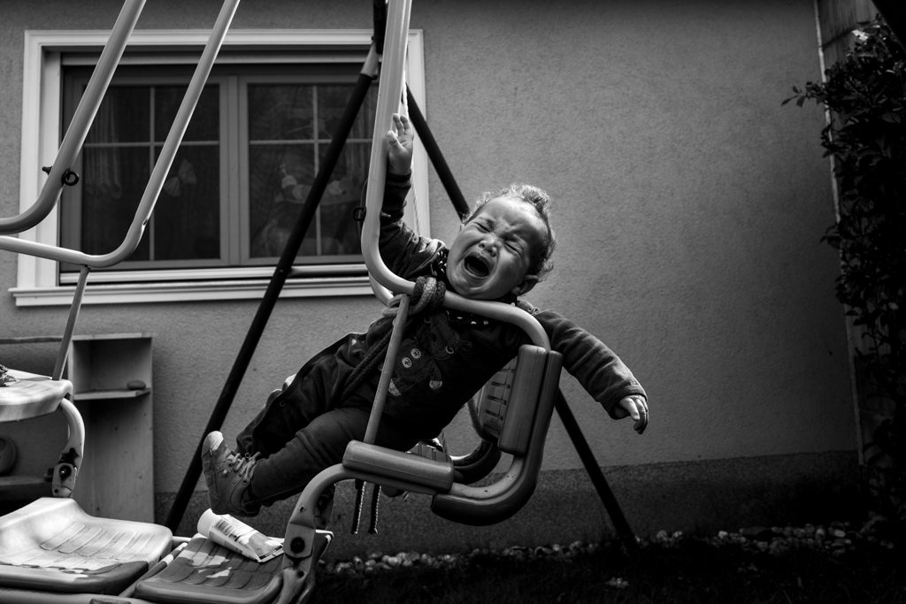 unhappy child on swing