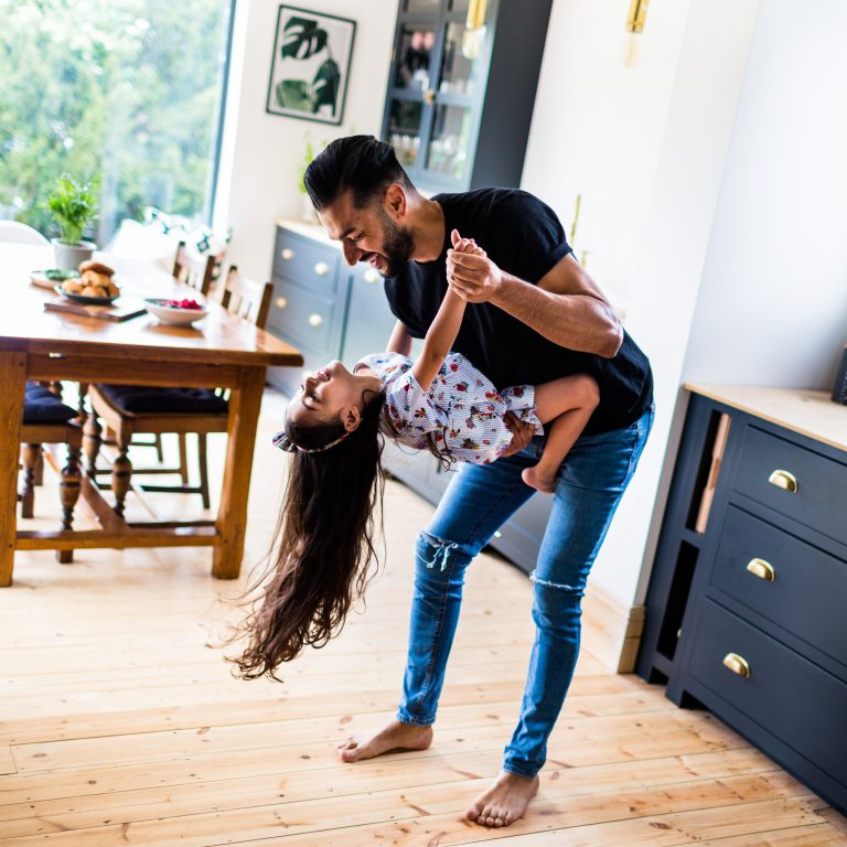 Documentary Family Photographers : Daddy and daughter dancing in the kitchen childhood, London