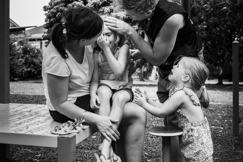 Documentary Family Photography: Family consoling crying girl. Brisbane, Australia.