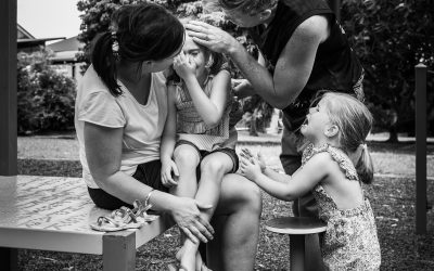 Documentary Family Photography: Family consoling crying girl. Brisbane, Australia.