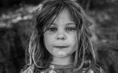 Documentary Family Photography: portrait of a little girl with dirt smudges on her face. Brisbane, Australia