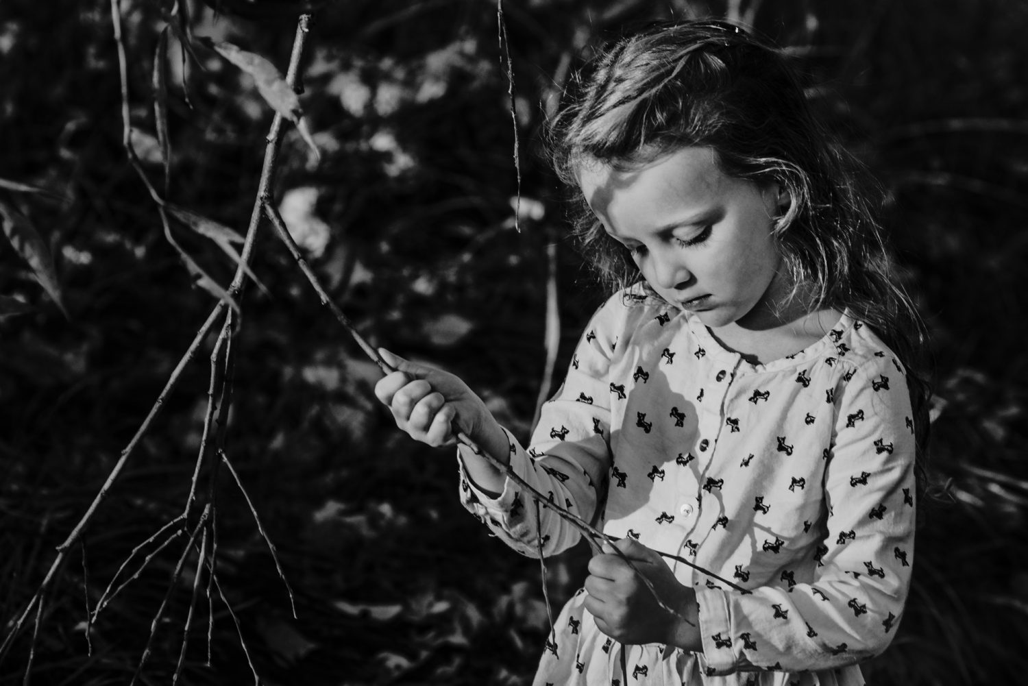 Documentary Photograph of girl with a branch