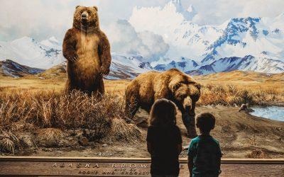 Documentary Family Photography: Two children look at a grizzly bear exhibit at the Museum of Natural History. New York, NY.