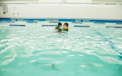 Documentary Family Photography: Father and son having fun together in a pool. New York, NY USA