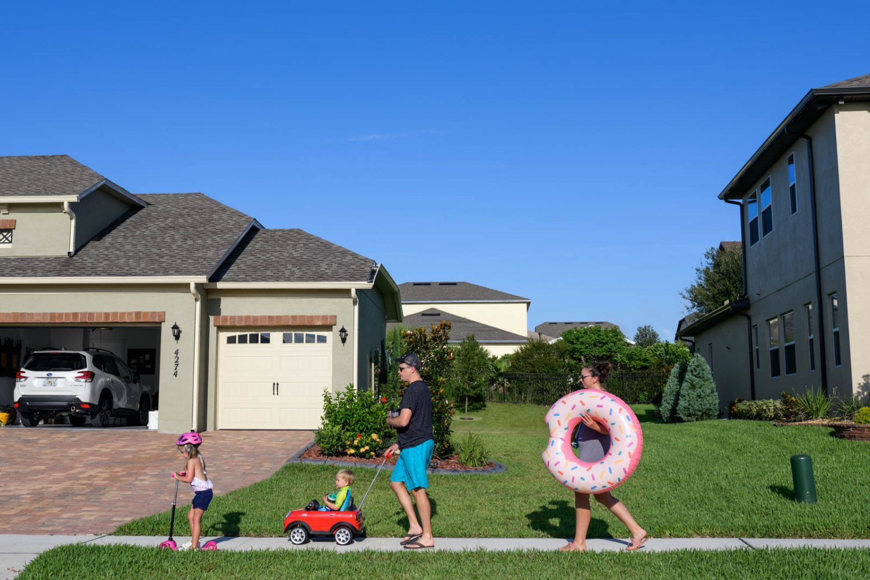 family walks to community pool
