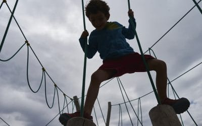 Kid playing on a mountaing playground
